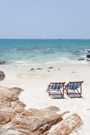 beach chair on white sand beach photo
