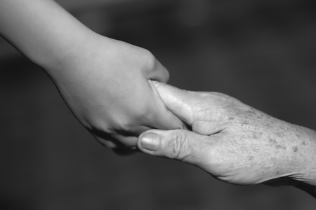 grasp: child holding old woman hand