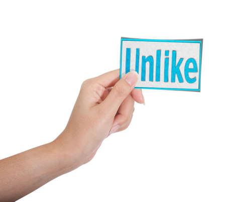 top hate: Isolated: hand holding unlike paper on white backgroud, like on social network concept