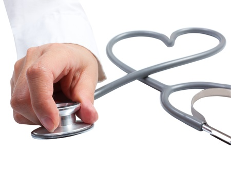 cardiac care: Female hand holding stethoscope; health care concept