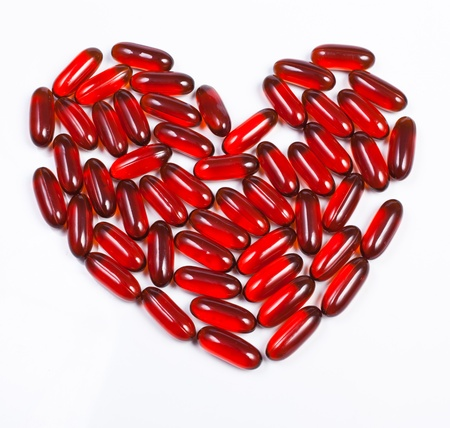 Heart made of red capsule photo