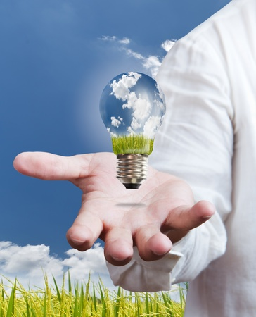 Light blub on hand at paddle and blue sky Stock Photo - 10256538