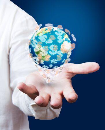 dollar earth globe in his hands photo
