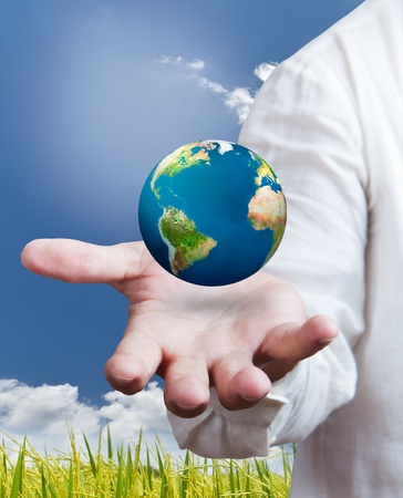 earth globe in his hands, saving environment concept photo
