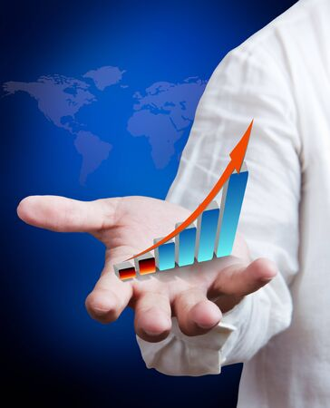 Business man holding growth graph with world map background Stock Photo - 10290045