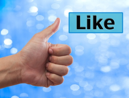 thumb up to Like button, social network concept photo