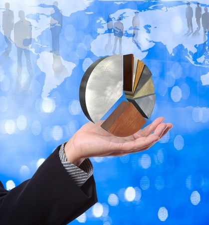 Business man holding pie graph with world map background Stock Photo - 10427417