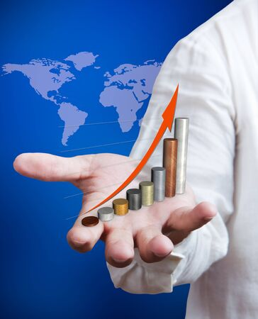 Business man holding growth graph with world map background Stock Photo - 10427387