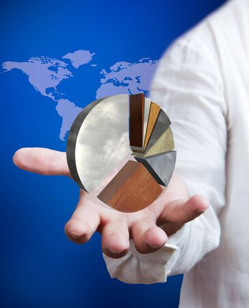 Business man holding growth graph with world map background Stock Photo - 10427393