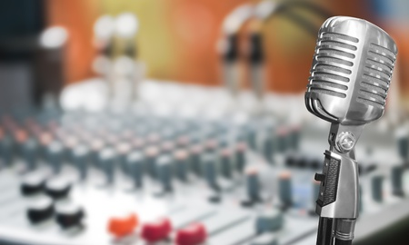 music production: Retro microphone with mixer background