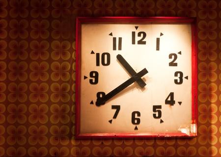 old clock on retro background photo