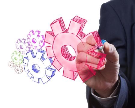 cogwheel: Business man drawing gear to success Stock Photo