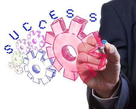 Business man drawing gear to success Banco de Imagens