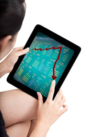 business Woman watching falling stock market on modern touch pad