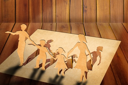 the warmth: Warmth family concept, make for cut out of paper on wood texture