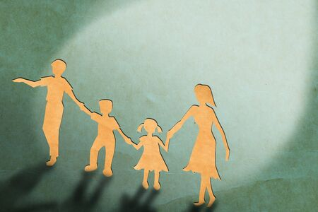 Warmth family concept, make for cut out of paper on vintage paper photo