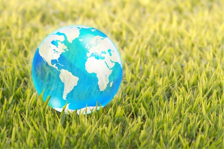 rice paddy: blue crystal globe on green background Stock Photo