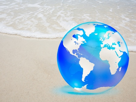 crystal globe over sand and  sea Stock Photo - 10849444
