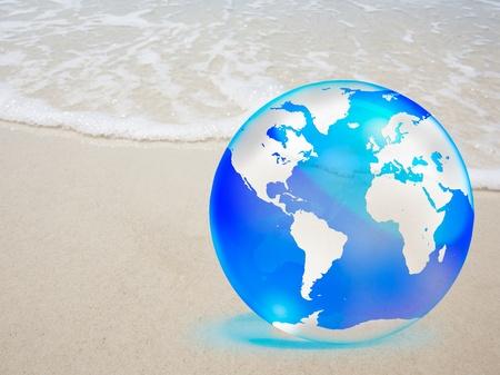 crystal globe over sand and  sea Stock Photo - 10849444