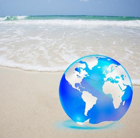 crystal globe over sand and  sea Stock Photo - 10849450