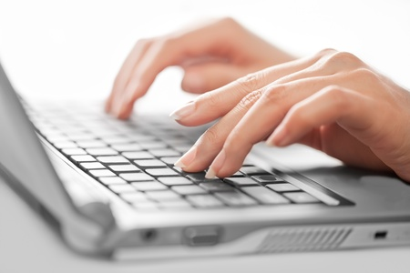 peripherals: Close-up of typing female hands, selective focus