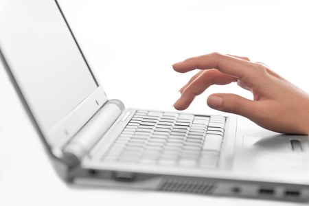 laptop keyboard: Close-up of typing female hands, selective focus