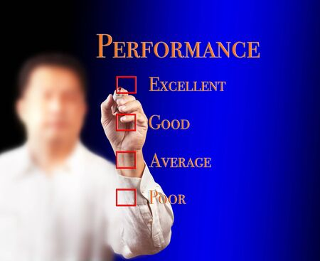 business man writing on performance audit checklist photo