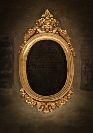 mirror on wall: Golden frame over vintage wallpaper