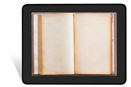 Vintage book in tablet pc photo