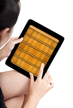 Woman toch application shelf of ebook on modle tablet pc photo