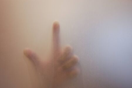 Finger touch on glass Stock Photo - 11570027