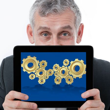 online trading: business man showing one computer tablet with 3d gear for collaboration of business success Stock Photo