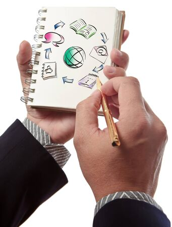 Business man writing collaboration diagram on book photo