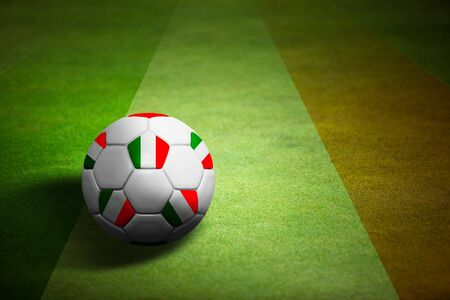 Flag of Italy with soccer ball over grass background - Euro 2012 championship photo