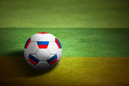 Flag of Russia with soccer ball over grass background - Euro 2012 championship photo