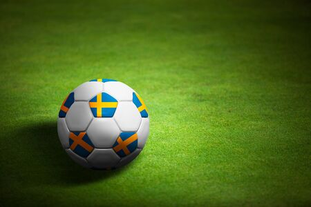 Flag of Sweden with soccer ball over grass background - Euro 2012 championship photo