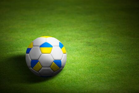 Flag of Ukraine with soccer ball over grass background - Euro 2012 championship photo
