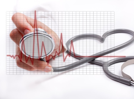 cardiologist: Female hand holding stethoscope; health care concept