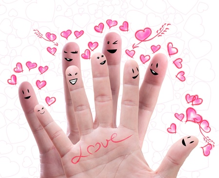 Happy group of finger faces  with their love offering photo