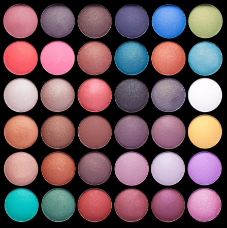 Make-up colorful eyeshadow palettes isolated on black background photo