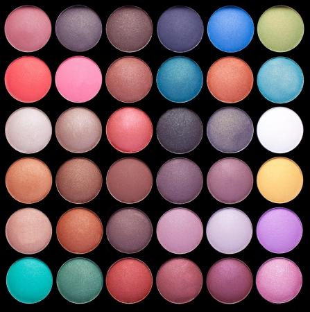 Make-up colorful eyeshadow palettes isolated on black background photo