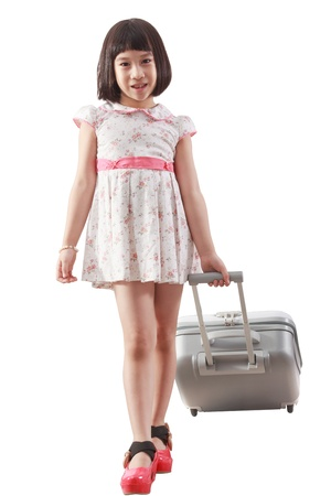 eye traveller: Cute asia girl pulling travel bag, holiday concept Stock Photo