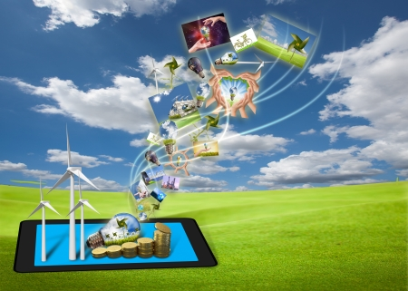 positive energy: saving energy stream images from tablet pc on the field with solar cell and wind turbine  Stock Photo