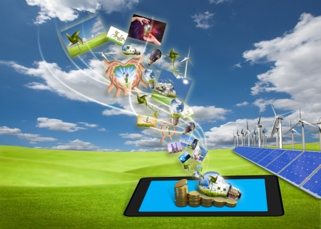 saving energy stream images from tablet pc on the field with solar cell and wind turbine Stock Photo - 15065593