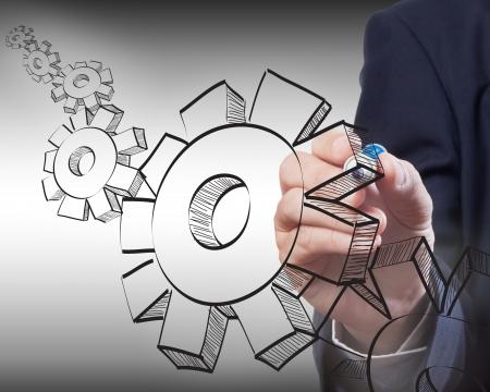 Business man drawing gear to success Standard-Bild