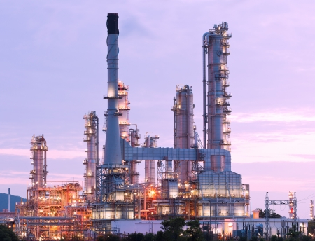 scenic of petrochemical oil refinery plant shines at night, closeup Standard-Bild