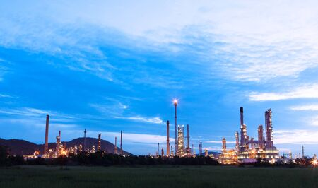 scenic of petrochemical oil refinery plant shines at night, closeup photo