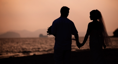 Romantic scene of love couples on the beach photo