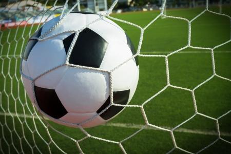 soccer net: Soccer ball in goal, success concept Stock Photo