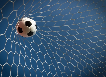 Soccer ball in goal, success concept photo